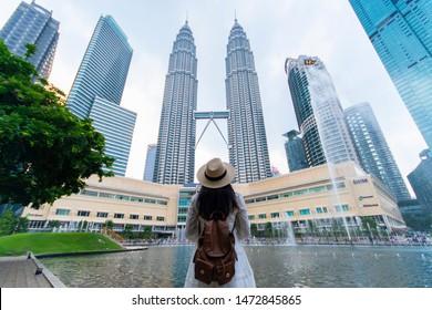 Kuala Lumpur, Malaysia 25/7/2019 A woman tourist is sightseeing the Petronas Twin tower KLCC in Kuala Lumpur.