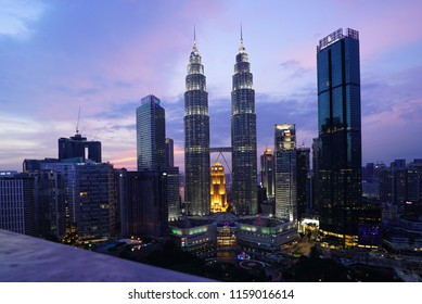 Kuala Lumpur, Malaysia – 26 July 2018: Petronas Twin Towers (fondly known as KLCC) and the surrounding buildings during sunset seen from the Skybar at Traders Hotel.