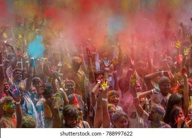 KUALA LUMPUR MALAYSIA -26 MARCH 2017: Huge crowds enjoy throwing colored powder and dance during Malaysia Largest Holi Festival in Kuala Lumpur.