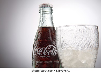 Kuala Lumpur, Malaysia 26th August 2016,Photo of the small 250 ml bottle of Coca-Cola Classic in a glass bottle. Isolated on White