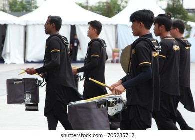 KUALA LUMPUR, MALAYSIA - 26th August 2017 :   Youth wearing black uniforms practice their instruments during training session at public area