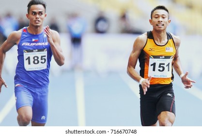 KUALA LUMPUR, MALAYSIA 27 AUGUST 2017: Athletes in action at the Men's 100meter Semi Final at the 29th SEA Games at the National Stadium in Bukit Jalil, Kuala Lumpur.