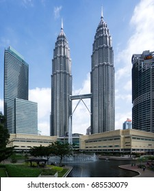 KUALA LUMPUR, MALAYSIA - 27 JULY 2017: Petronas twin tower view from KLCC park with lake foreground at noon. Petronas twin tower is the iconic building among tourists visiting Malaysia.