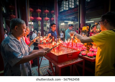 Kuala Lumpur, Malaysia 28 January 2017 : Candles being lit in the temple on the first day of Chinese New Year. Low light
