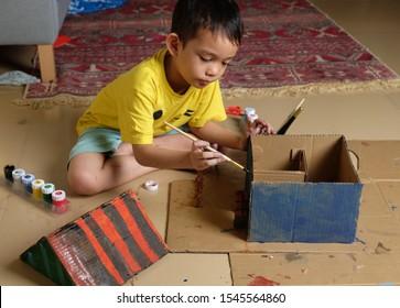 Kuala Lumpur, Malaysia 29 Oct 2019 : Children building and painting cardboard house.