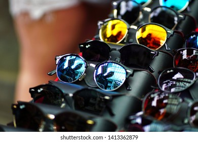 Kuala Lumpur, Malaysia - 2nd June 2019 : Colourfull sunglass reflections with leather case on the display table