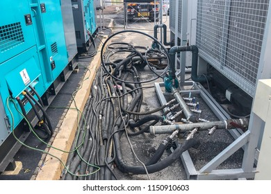 Kuala Lumpur, Malaysia : 3 August 2018 - Cable and Piping for and outdoor Generator laid on the tarmac