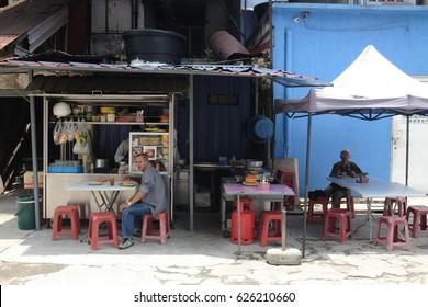 Kuala Lumpur, Malaysia - 3 March 2017 : Customers enjoying their lunch at the Indian food stall in Kuala Lumpur.