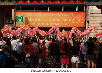 Kuala Lumpur, Malaysia 30 Jan 2019 : Chinese comunity taking part in ceremonial parade of puppets and lion dance in Kuala Lumpur Chinatown.