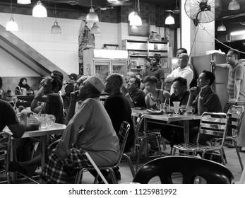 Kuala Lumpur, Malaysia,  30 Jun 2018: people watching a worldcup football at mamak restaurant  a match between Argentina vs France in Kuala Lumpur, Malaysia.