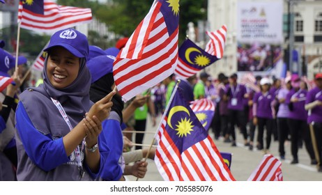 Kuala Lumpur, Malaysia - 30th August 2017: People are celebrating by waving Malaysian flags during the pre trial preparation for upcoming Medeka (independence day) celebration.