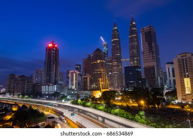 KUALA LUMPUR, MALAYSIA - 30TH JULY 2017; Semi-silhouette of Kuala Lumpur city during sunrise. Its modern skyline is dominated by the 451m-tall KLCC, a pair of glass-and-steel-clad skyscrapers.