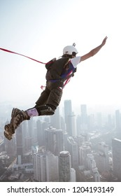 KUALA LUMPUR, MALAYSIA - 30th SEP 2018; A BASE jumpers in jumps off from KL Tower. KL Tower BASE Jump is an annually event and participants from experienced BASE jumpers from all around the world.