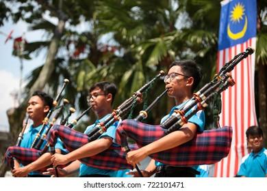 Kuala Lumpur, Malaysia. 31st August, 2017 : Teenager music band performing patriotic melody with bagpipe at Merdeka square, Kuala Lumpur, Malaysia.