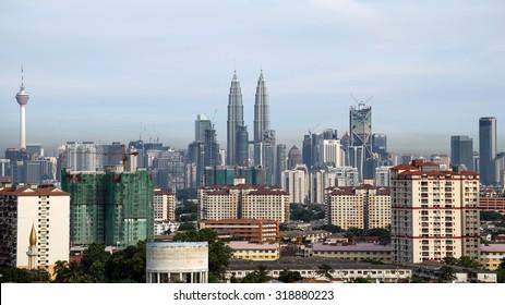 KUALA LUMPUR, MALAYSIA - 31ST MAY 2014; Cloudscape view of the Petronas Twin Towers and Kuala Lumpur skyline.