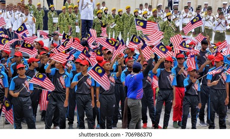 Kuala Lumpur, Malaysia - 31th August 2017: People are celebrating by waving Malaysian flags during the Medeka (independence day) celebration.