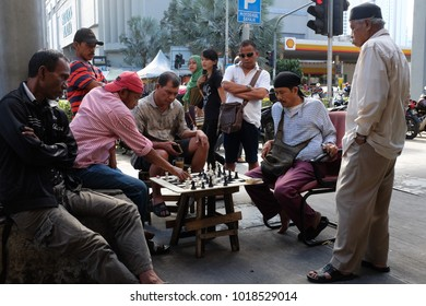Kuala Lumpur, Malaysia 4 Feb 2018 : Crowd of people watching street chess match at Chow Kit Road in Kuala Lumpur on Feb 4.