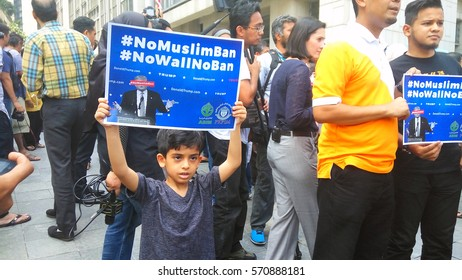 KUALA LUMPUR, MALAYSIA - 4th February 2017 : A Muslim boy holding a sign board protesting against the new immigration laws banning some Muslims at Menara Tabung Haji area among others.