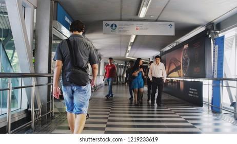 Kuala Lumpur, Malaysia, 5 july 2018. Unidentified people walk through overpass.