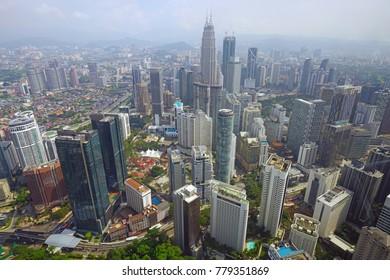 KUALA LUMPUR, MALAYSIA -6 DEC 2017- Day view of the modern Kuala Lumpur skyline including the Petronas Twin Towers from the KL Tower located in Kuala Lumpur, Malaysia.