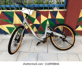 KUALA LUMPUR MALAYSIA, 6 JULY 2018: An abandoned and vandalize sharing city bike known as OBike which are the public bicycle rental service provided in Malaysia.
