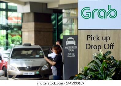 Kuala Lumpur, Malaysia - 6 June2019 :  Passenger taking a grab car service at grab car pick-up and drop-off point at a shopping mall in Kuala Lumpur.