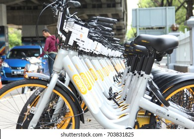 KUALA LUMPUR, MALAYSIA - 6th August 2017: oBike bikes are placed in line in Bukit Jalil Stadium. oBike is a stationless bicycle-sharing system with built-in lock and GPS system.