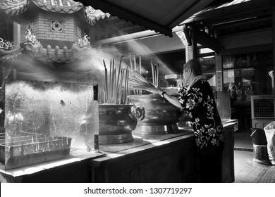 Kuala Lumpur, Malaysia -7 Feb 2019: Chinese devotees performing morning prayer at Buddhist temple in Chinatown, Kuala Lumpur.