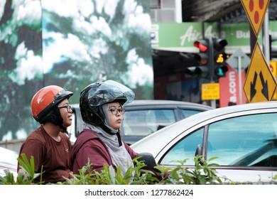 Kuala Lumpur, Malaysia 7 Jan 2019 : Street scene of man riding Harley Davidson motocycle around Bukit Bintang shopping area in Kuala Lumpur.
