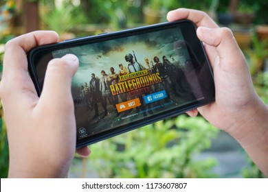 Kuala Lumpur, Malaysia - 7 September 2018: Hand holding a smartphone with Player's Unknown Battleground also known as PUBG online shooting gaming