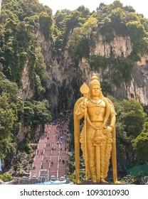 KUALA LUMPUR, MALAYSIA - 7TH APRIL 2017: The outside of the Batu Caves in Kuala Lumpur, Malaysia. The huge LordMurugan hindu deity can be seen.