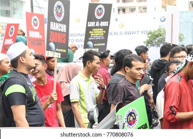 KUALA LUMPUR, MALAYSIA - 8 December 2017: Protesters gather to protest and condemns Donals Trump decision to make Baitulmaqdis or Jerusalem as Israel's capital. Hundreds march outside the US embassy