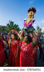 Kuala Lumpur, Malaysia 9 February 2017: Women devotees  and offering on the way to temple during Thaipusam