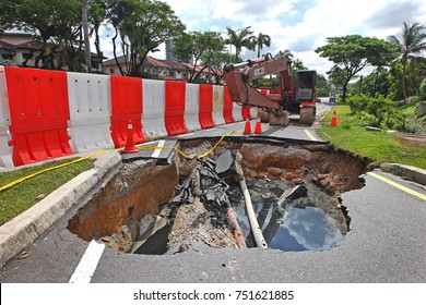 KUALA LUMPUR MALAYSIA -9 NOVEMBER 2017: After a downpour, a giant sinkhole had swallowed traffic lights and cut off power in Kuala Lumpur.