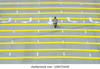 KUALA LUMPUR, MALAYSIA - APRIL 02, 2018: A motorcycle rides on rumble strips. Rumble strips is a common choice to reduce vehicle speed and increase driver alertness on roadway.
