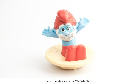 Kuala Lumpur, Malaysia - April 02, 2015: Papa Smurf figure sitting on a spinning top. Papa is the third oldest Smurf and the leader of all Smurfs from the comic strip of The Smurfs