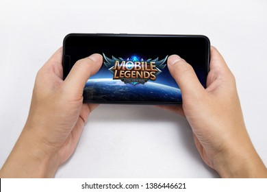 KUALA LUMPUR, MALAYSIA - APRIL 11, 2019: Mobile Legends game app in the smartphone isolated on white background.
