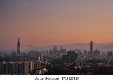 Kuala Lumpur, Malaysia - Kuala Lumpur, Malaysia - April 12 2020: Sunrise golden hour view of Kuala Lumpur city icon building Twin tower KLCC, KL Tower, TRX Exchange and PNB118. image shoot from Cheras