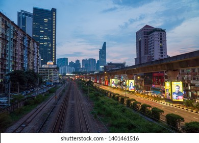 Kuala Lumpur, Malaysia - April 12th, 2019 : City of Bangsar landmark, train KTM railway, overlooking famous Menara TM or TM tower with sunset scene.
