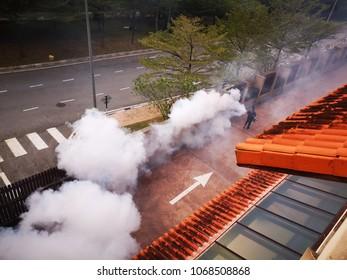 Kuala Lumpur, Malaysia - April 14. Unidentified man fogging chemical to anti mosquitoes