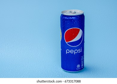 KUALA LUMPUR, MALAYSIA - APRIL 17,2016 : Cold and icy Pepsi can against blue background. Pepsi is a carbonated soft drink produced by PepsiCo.