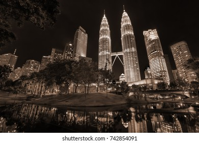 Kuala Lumpur, Malaysia - April 18, 2015: Petronas Twin towers with reflection in a water, Kuala Lumpur central park, KLCC