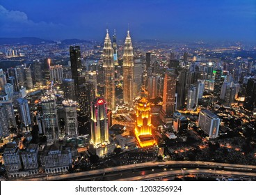 KUALA LUMPUR, MALAYSIA - APRIL 18th, 2018 : Majestic view of Petronas Twin Towers with background Kuala Lumpur cityscape. Petronas Twin Towers also known as KLCC is the tallest building in Malaysia