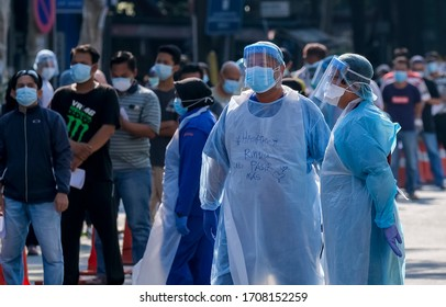 KUALA LUMPUR, MALAYSIA - APRIL 19, 2020: Medical personnel helps the public to do the COVID-19 test to taking nasal and mouth swab at Kampung Baru. Coronavirus disease 2019 (COVID-19) outbreak.