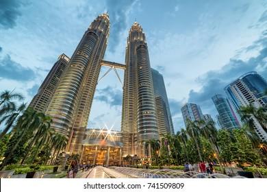 Kuala Lumpur, Malaysia - April 19, 2015: Petronas Twin towers, Kuala Lumpur central park KLCC