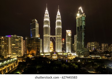 KUALA LUMPUR, MALAYSIA - April 2: Petronas Twin Towers at night on April 2, 2017 in Kuala Lumpur. Petronas Twin Towers were the tallest buildings (452 m) in the world from 1998 to 2004.