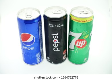 Kuala Lumpur, Malaysia - April 2019. Variety of carbonated drink in cans against white background, pepsi and 7up