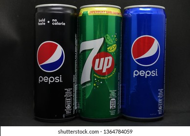 Kuala Lumpur, Malaysia - April 2019. Variety of carbonated drink in cans against black background, pepsi and 7up