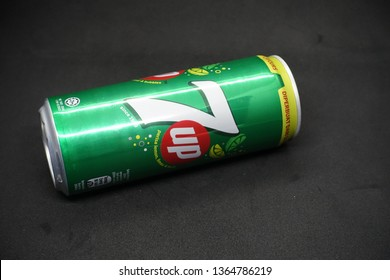 Kuala Lumpur, Malaysia - April 2019. A 7up can against isolated black background, a tasty fruits flavour carbonated drink