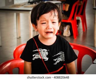 KUALA LUMPUR, MALAYSIA- APRIL 20,2016 : Boy crying with black hairstyle